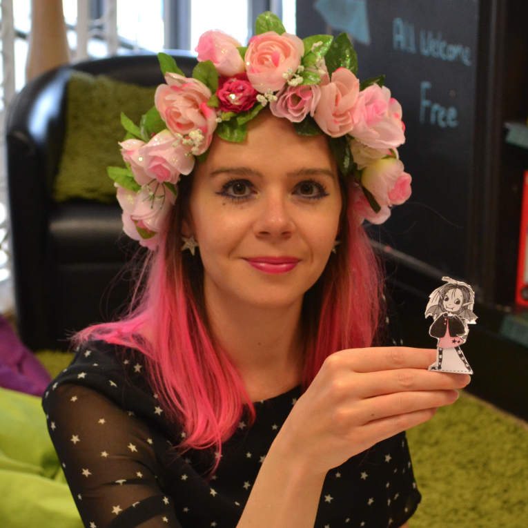 Harriet Muncaster with an Isadora Moon dress up doll cut out and dressed by a little girl