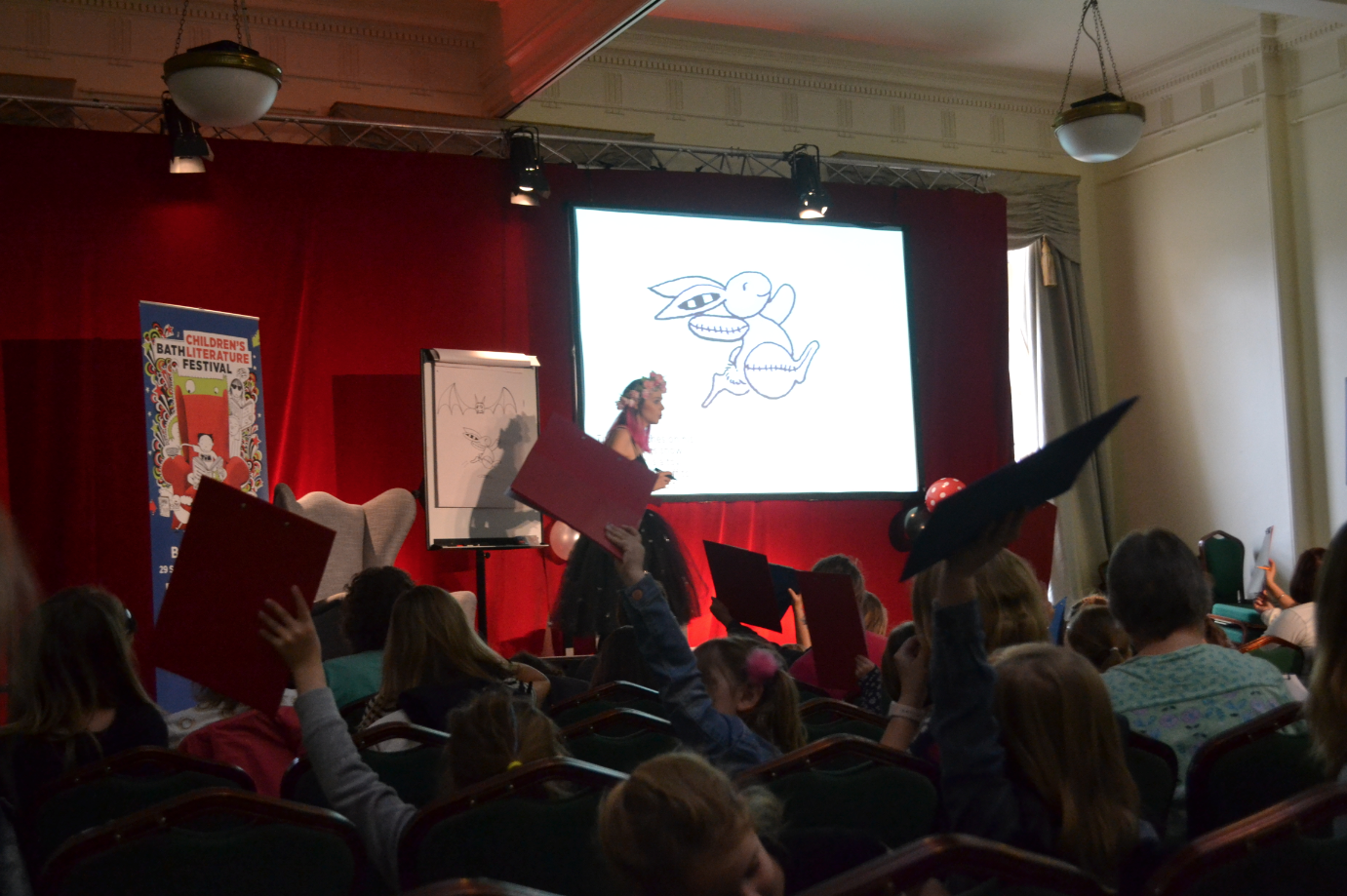 Harriet Muncaster performing an Isadora Moon event at Bath Children's Literature Festival
